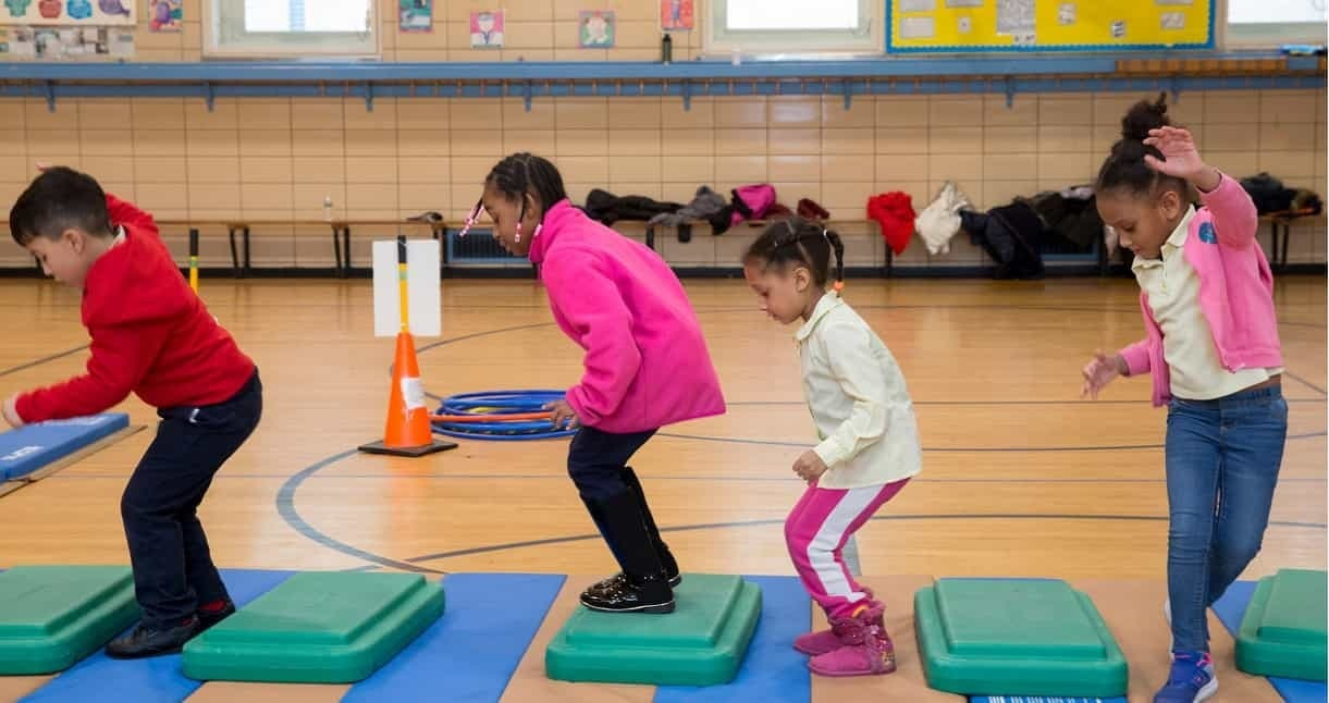 Kids playing in gym class at school